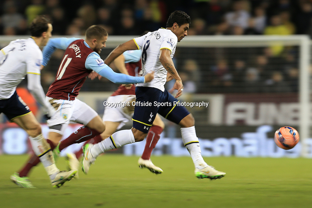 5th January 2015 - FA Cup - 3rd Round - Burnley v Tottenham Hotspur - Paulinho of Spurs escapes a challenge - Photo: Simon Stacpoole / Offside.