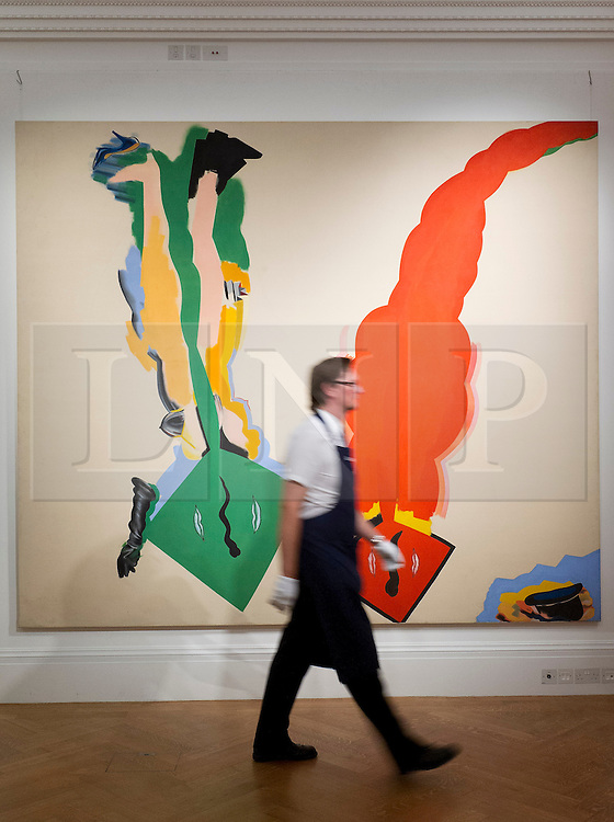"© Licensed to London News Pictures. 03/09/2013. London, UK. A Sotheby's employee walks past ""Male and Female Composition"" (1964-65) by Allen Jones during the press view for an exhibition of art from the 1960's at Sotheby's in London today (03/09/2013). The exhibition, entitled ""The New Situation: Art in London in the Sixties"" and located at the auction house's New Bond Street building, is open to the public from 4th to the 11th of September 2013. Photo credit: Matt Cetti-Roberts/LNP"