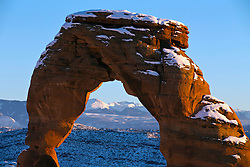 Detailed view of Delicate Arch with snow in winter at sunset, Arches National Park, Utah, United States of America