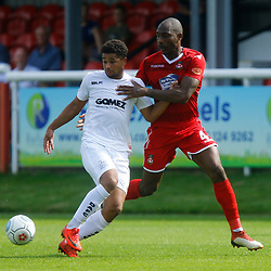 Dovers forward Jamie Allen keeps the ball away from Wrexhams defender Emanuel Smith during the opening National League match between Dover Athletic and Wrexham FC at Crabble Stadium, Kent on 04 August 2018. Photo by Matt Bristow.