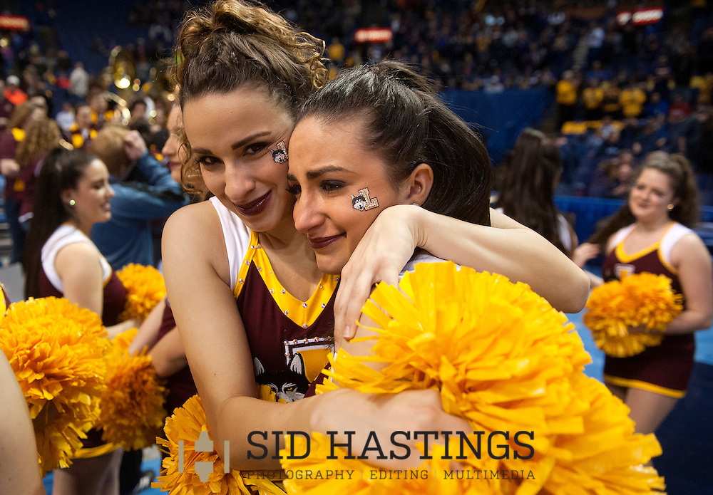4 MARCH 2016 -- ST. LOUIS -- Loyola University Chicago's cheerleaders embrace after the Ramblers game against Wichita State University during the second round of the 2016 Missouri Valley Conference Arch Madness men's basketball tournament at the Scottrade Center in St. Louis Friday, March 4, 2016. Wichita State topped Loyola 66-58..<br /> <br /> Photo &copy; copyright 2016 Sid Hastings.