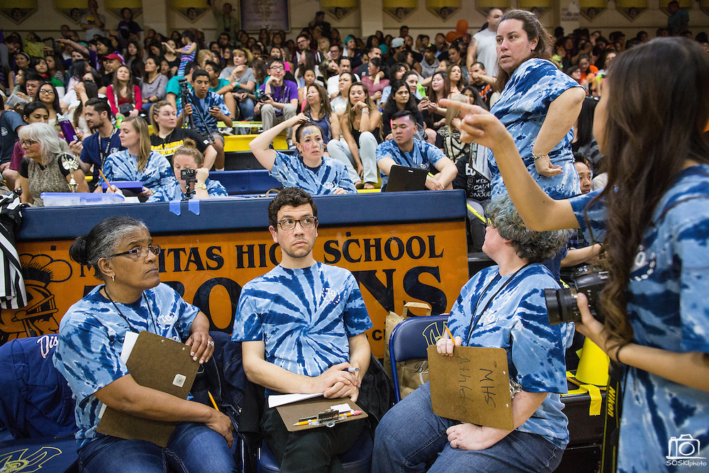 Judges (MHS Teachers) are confused during the final steps of tallying up the points during the annual Trojan Olympics, where students compete in various unorthodox events for class bragging rights, at Milpitas High School in Milpitas, California, on March 27, 2015. (Stan Olszewski/SOSKIphoto)