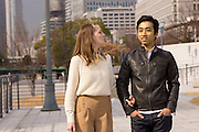 A young couple, a Caucasian woman and Japanese man in Osaka.