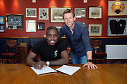 17/05/2017 - Dundee new boy Elton Ngwatala pictured with Dundee manager Neil McCann at Dens Park, Dundee, Picture by David Young -