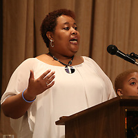Shena Sorrell does the Invocation for Saturday's Sister, S.O.A.R. empowerment luncheon
