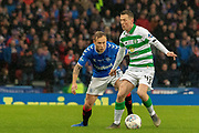 Scott Arfield of Rangers FC keeps a watchful eye on Callum McGregor of Celtic FC during the Betfred Scottish League Cup Final match between Rangers and Celtic at Hampden Park, Glasgow, United Kingdom on 8 December 2019.