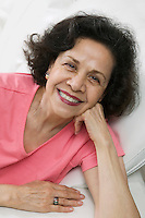 Smiling middle-aged Woman on sofa portrait