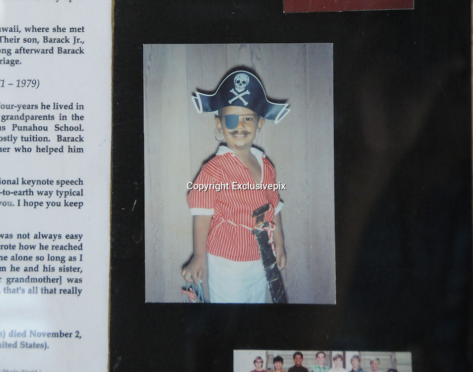 """Apr 18, 2011 - Honolulu, Hawaii - <br /> Obama Photo Shrine in Hawaii<br /> Long before he was captain of the ship of state, President Obama dreamed of a life at sea - aboard a pirate ship.<br /> This early photo of the Commander in Chief, all dolled up like a Master and Commander in a Halloween costume, is part of a photo shrine to the 44th President in Hawaii.<br /> The shrine is in a block of flats where young Obama, then known as Barry, lived with his grandparents, Madelyn and Stanley Armour Dunham. The pictures show an idyllic childhood with his family.<br /> Barack Obama's mother, Ann Dunham, married Barack Oabama Sr. after they met at the University of Hawaii in 1960. After they divorced, Ann married Lolo Seotoro, an Indonesian student, and moved with young Barack to Indonesia, where they lived until he was ten, before returning to Hawaii to live with his grandparents. Obama's grandfather Stanley died in 1992, followed by his mother, a victim of cancer in 1995. His grandmother, Madelyn - whom he lovingly called """"Toot"""" - died on Nov. 2, 2008, just two days before her grandson was elected President of the United States.<br /> Photo Shows: A Young Obama Ready for a Halloween Party<br /> (Credit Image: © Craig Kojima/Exclusivepix)"""