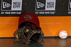SAN FRANCISCO, CA - SEPTEMBER 05: Detailed view of a Arizona Diamondbacks hat and Wilson baseball glove in the dugout before the game against the San Francisco Giants at AT&T Park on September 5, 2012 in San Francisco, California. The Arizona Diamondbacks defeated the San Francisco Giants 6-2. (Photo by Jason O. Watson/Getty Images) *** Local Caption ***