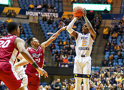 Nov 28, 2018; Morgantown, WV, USA; West Virginia Mountaineers guard Brandon Knapper (2) shoots a jumper during the second half against the Rider Broncs at WVU Coliseum. Mandatory Credit: Ben Queen-USA TODAY Sports