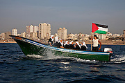High school students enjoy a field trip on the Mediterranean Sea off the Gazan coast---the ten minute boat ride an adventure as they are not allowed to travel outside of the Gazan enclave due to the siege.