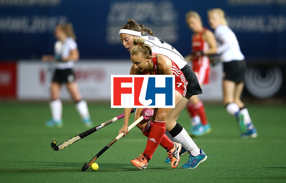 JOHANNESBURG, SOUTH AFRICA - JULY 14:  Hannah Martin of England battles with Teresa Martin Pelegrina of Germany during day 4 of the FIH Hockey World League Women's Semi Finals Pool A match between Germany and England at Wits University on July 14, 2017 in Johannesburg, South Africa.  (Photo by Jan Kruger/Getty Images for FIH)