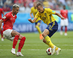 SAINT PETERSBURG, July 3, 2018  Valon Behrami (L) of Switzerland vies with Viktor Claesson of Sweden during the 2018 FIFA World Cup round of 16 match between Switzerland and Sweden in Saint Petersburg, Russia, July 3, 2018. Sweden won 1-0 and advanced to the quarter-final. (Credit Image: © Cao Can/Xinhua via ZUMA Wire)