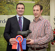 Scottish National Premier Meat Exhibition & competition to promote Scottish livestock from farm to consumer, sponsored by Marks & Spencer. Held at Scotbeef Ltd, Bridge of Allan, Saturday 19th Novermber, 2011..Malcolm Copland, head of trading at Marks & Spencer presents ? Messrs WA Fettes, Braes of Enzie, Buckie - best AA carcase