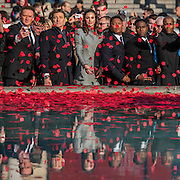 Laura Wright, joined by Russell Watson ((L of Ben), Ben Shepherd (L) and members of Vox Fortura (R), throws poppies in the fountain - Silence in the Square oraganised by the British Legion in Trafalgar Square  - 11 November 2016, London.