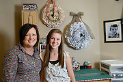 Rebecca Hanson and her daughter Savannah, 14, pose for a portrait at their wreath work space at her home in Fort Worth on Wednesday, March 13, 2013. (Cooper Neill/The Dallas Morning News)