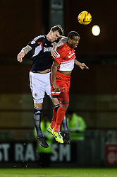 Bristol City Defender Aden Flint (ENG) and Leyton Orient Midfielder Moses Odubajo (ENG) compete in the air - Photo mandatory by-line: Rogan Thomson/JMP - 07966 386802 - 11/02/2014 - SPORT - FOOTBALL - The Matchroom Stadium, London - Leyton Orient v Bristol City - Sky Bet Football League 1.