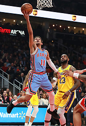 February 12, 2019 - Atlanta, GA, USA - Atlanta Hawks guard Trae Young goes to the basket past Los Angeles Lakers forward LeBron James for two points during the first half on Tuesday, Feb. 12, 2019 in Atlanta, Ga. (Credit Image: © Curtis Compton/Atlanta Journal-Constitution/TNS via ZUMA Wire)