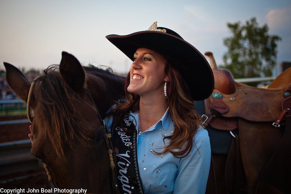 "during the Prince William County Fair, in Manassas, VA, on Sunday, August 10, 2014. John Boal PhotographyMelissa McMullan, Miss Rodeo Virginia 2014, of Ft. Valley, VA, stands with her horse, Sarah, during the Dave Martin Rodeo, at the Prince William County Fair, in Manassas, VA, on Sunday, August 10, 2014.  McMullan represents Virginia regionally and nationally, while promoting ""rodeos and the western lifestyle"" in Virginia.  John Boal Photography"