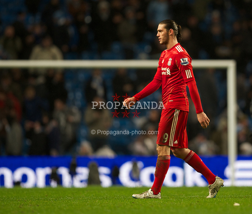 MANCHESTER, ENGLAND - Tuesday, January 3, 2012: Liverpool's Andy Carroll walks off dejected after his side's 3-0 defeat by Manchester City during the Premiership match at the City of Manchester Stadium. (Pic by David Rawcliffe/Propaganda)