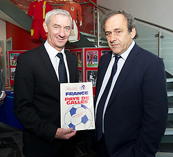 NEWPORT, WALES - Saturday, April 20, 2013: FAW Trust Elite Performance Director Ian Rush with UEFA President Michel Platini, with a programme from when Wales beat France, at the opening of the FAW National Development Centre in Newport. (Pic by David Rawcliffe/Propaganda)