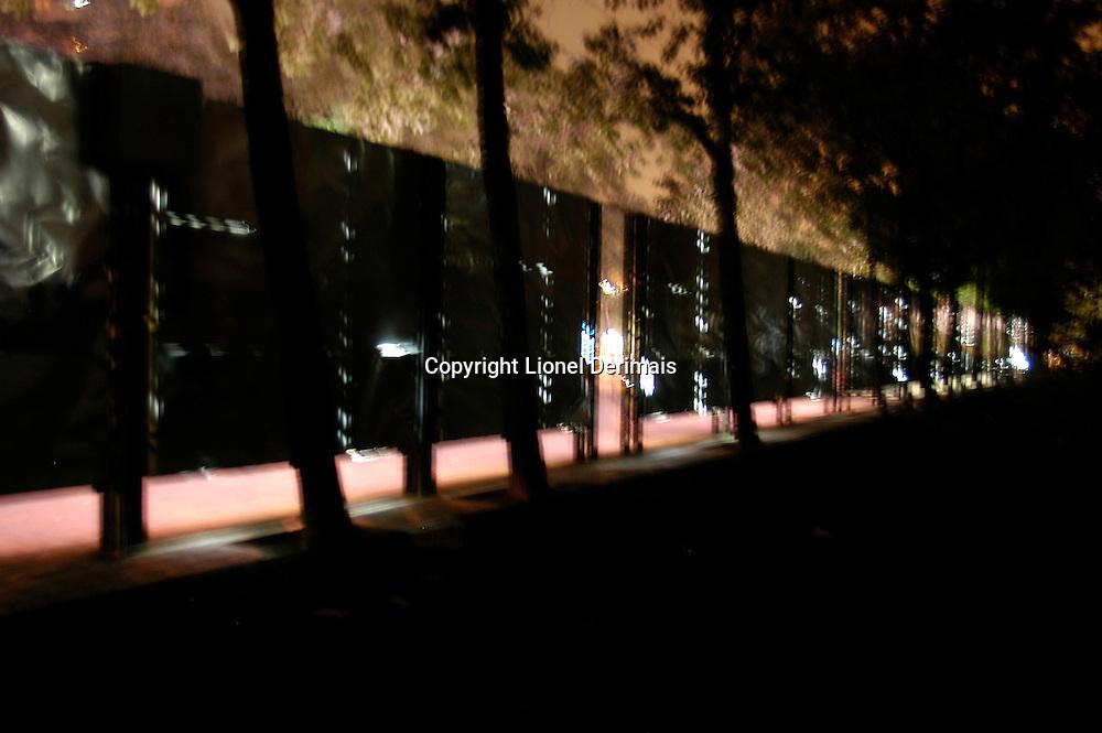 Advertising boards at night on Gongti Beilu in Beijing.