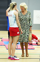 Image licensed to i-Images Picture Agency. 23/07/2014. Glasgow, United Kingdom. The Duchess of Cornwall talks to England badminton player Gabrielle Abcock during a visit  to the Commonwealth Games in Glasgow  Picture by Stephen Lock / i-Images