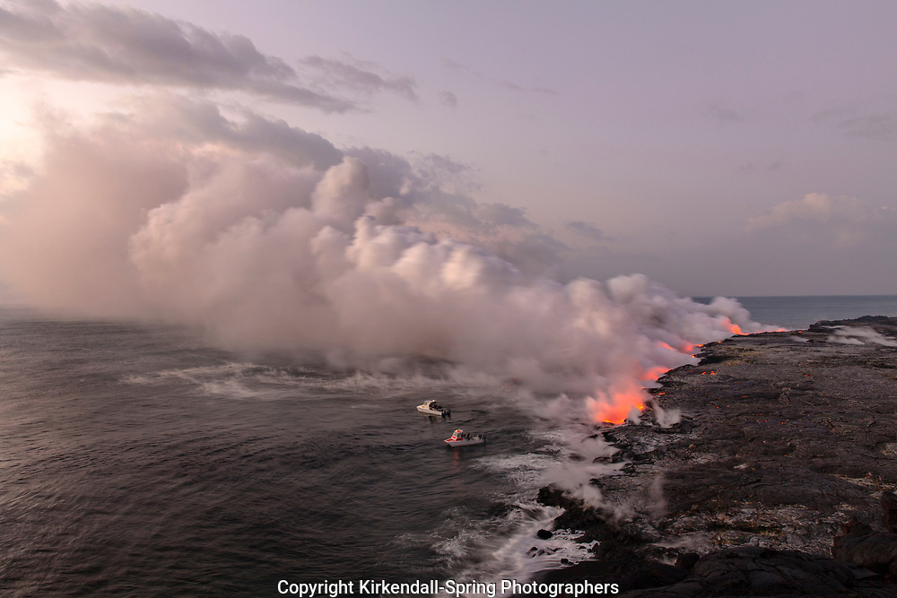HI00343-00...HAWAI'I - Boats approaching lava flowing into the Pacific Ocean from the East Riff Zoneof the Kilauea Volcano on the Island of Hawai'i.