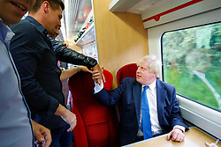 © Licensed to London News Pictures. 02/06/2017. London, UK. Foreign Secretary BORIS JOHNSON shake hands with members of public on a train to York, England on Friday, June 2, 2017. Photo credit: Tolga Akmen/LNP