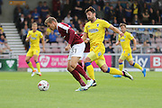 AFC Wimbledon midfielder Chris Whelpdale (11) and Northampton Town midfielder Matthew Taylor (31) in action during the EFL Sky Bet League 1 match between Northampton Town and AFC Wimbledon at Sixfields Stadium, Northampton, England on 20 August 2016. Photo by Stuart Butcher.