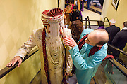 Baltimore, Maryland - December 20, 2014: Eshwan Ramudu's best man Alex Bick peeks through his Sehra during the elevator ride portion of his baraat inside the Baltimore Marriott Waterfront Hotel. <br /> <br /> Trisha Satya Pasricha and Eshwan Ramudu married at the Baltimore Marriott Waterfront Hotel December 20, 2014. <br /> <br /> <br /> CREDIT: Matt Roth for The New York Times<br /> Assignment ID: 30168620A