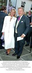 SIR ANTHONY & LADY BAMFORD at a wedding in Suffolk in London on 20th September 2003.PMT 230