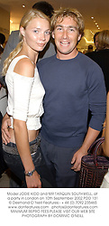 Model JODIE KIDD and MR TARQUIN SOUTHWELL, at a party in London on 10th September 2002.PDD 131
