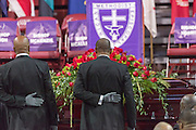 Pole bearers stand in a moment of silence at the casket of slain State Senator Clementa Pinckney at the TD Arena June 24, 2015 in Charleston, South Carolina. Pinckney is one of the nine people killed in last weeks Charleston church massacre.