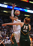 Sep 5, 2010; Phoenix, AZ, USA; Phoenix Mercury forward Candice Dupree (4) is fouled by Seattle Storm forward Lauren Jackson (15) during the first quarter in game two of the western conference finals in the 2010 WNBA Playoffs at US Airways Center.  Mandatory Credit: Jennifer Stewart-US PRESSWIRE