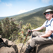 A hiker takes a break in the heath zone on Mt Kilimanjaro's Lemosho Trail at about 10,000 feet.