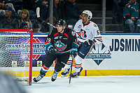 KELOWNA, CANADA - SEPTEMBER 22:  Montana Onyebuchi #5 of the Kamloops Blazers checks Ethan Ernst #19 of the Kelowna Rockets during first period on September 22, 2018 at Prospera Place in Kelowna, British Columbia, Canada.  (Photo by Marissa Baecker/Shoot the Breeze)  *** Local Caption ***