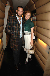 Actress EMILIA FOX and DANIEL ERDMAN renowned hairstylist at the launch party of Lisa Hoffman's new bath and shower range, held at Harvey Nichols, Knightsbridge, London on 23rd October 2007. <br />
