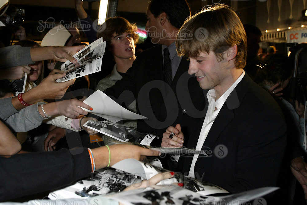 Oct 28, 2004; Newport Beach, CA, USA; Cast Member BENJAMIN MCKENZIE who plays Ryan on the FOX hit TV show 'The OC' visited the Balboa Penninsula in Newport Beach to get a Key to the City and be immortalized in cement with thier hand prints to be placed at the enterance to the Historic Balboa Pavillion.  Benjamin signs autographs for real OC Fans.  Mandatory Credit: Photo by Shelly Castellano/ZUMA Press.