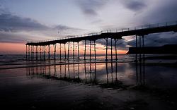 © Licensed to London News Pictures. 08/01/16<br /> Saltburn, UK. <br /> <br /> Day breaks over the pier at Saltburn beach. <br /> <br /> Photo credit : Ian Forsyth/LNP