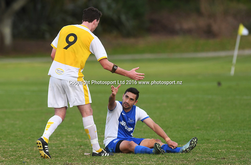 Damien Mosquera offers a hand to Wanderers' Alex Valera. Chatham Cup Football, Round 2. Eastern Suburbs v Hamilton Wanderers, Madills Farm, Auckland, New Zealand. Monday 6 June 2016©Copyright photo: Andrew Cornaga/www.photosport.nz
