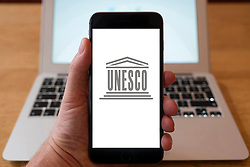 Using iPhone smartphone to display logo of UNESCO