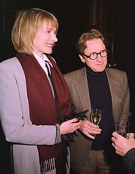 MR & MRS JOHN SWANNELL, he is the photographer, at a reception in London on 20th January 1999.MNI 11