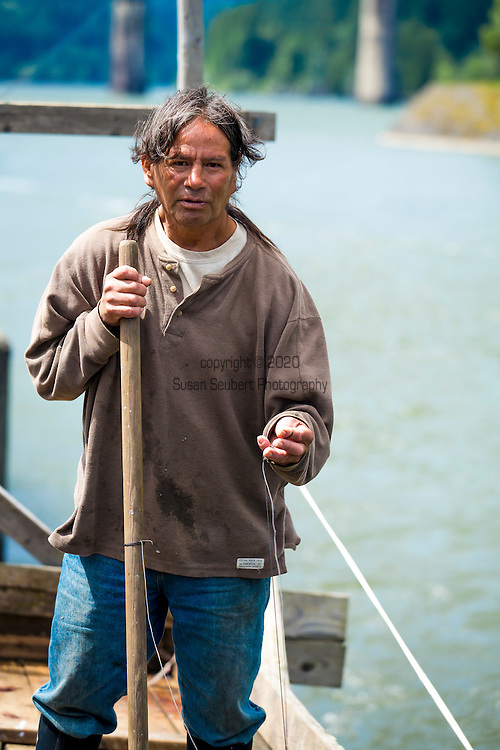 Ralf Jones, from the Nez Perce tribe, fishing from a traditional Native American platform on the Columbia River at Cascade Locks, Oregon