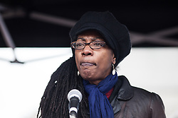 © Licensed to London News Pictures. 19/03/2016. London, UK. Marcia Rigg, sister of Sean Rigg who died in police custody in 2008, speaks to demonstrators in Trafalgar Square. Thousands march through central London on UN anti-racism day to demand that the British government accept a greater share of refugees seeking asylum in Europe. Photo credit : Rob Pinney/LNP