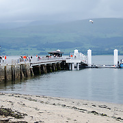 The waterfront and pier in Beaumaris on the island of Anglesey of the north coast of Wales, UK.