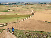 Just after Castrojeriz, the Way of Saint James continued on the Meseta across an endless dry plain. Here pilgrims look forward to a long dusty track ahead.