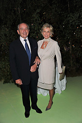 MR & MRS PHILIP HARARI at a dinner hosted by Cartier in celebration of the Chelsea Flower Show held at Battersea Power Station, 188 Kirtling Street, London SW8 on 23rd May 2011.