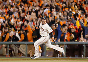San Francisco Giants's Travis Ishikawa rounds the bases after his walk-off homerun to win the National League Championship Series and a trip to the 2014 World Series.