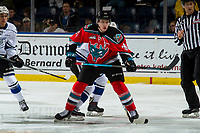 KELOWNA, CANADA - DECEMBER 7: Kyle Topping #24 of the Kelowna Rockets wins the face off against the Victoria Royals  on December 7, 2018 at Prospera Place in Kelowna, British Columbia, Canada.  (Photo by Marissa Baecker/Shoot the Breeze)